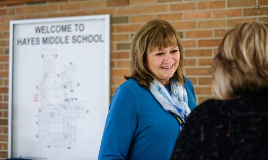 Julie Taylor, principal at Hayes Middle School in Grand Ledge talks with a staff member in the hallway Monday, Oct. 15, 2018. Taylor received a stem cell transplant at the end of January, and is recovering.