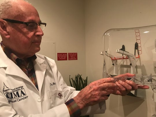 Dr. Jerrold Weiss, director of imaging at Capital Internal Medicine Associates in Haslett, shows a new curved paddle Oct. 4, 2018. Weiss said it helps decrease discomfort during breast screenings.