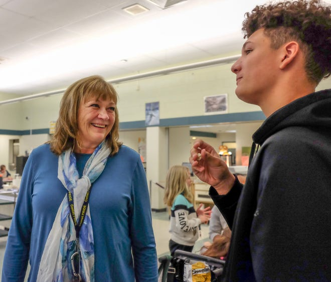 Principal Julie Taylor, talks with Justice Dungey during lunch-time Monday, Oct. 15, 2018. She is fighting a rare form of cancer and needs a stem cell transplant.