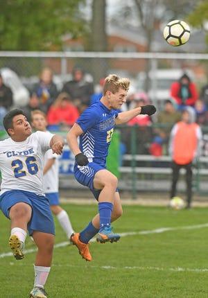 Kadin Hooks of Ontario heads the ball away from Clyde's Javi Ramirez on Monday night at Ontario High School.