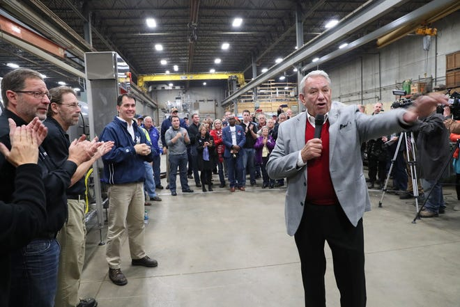 Former Gov. Tommy Thompson (front right) speaks at a rally for then-Gov. Scott Walker (left rear) last year at Pro Engineering and Manufacturing in Milwaukee.