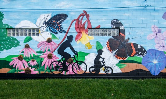 This mural painted by local artist Fred Kaems, on the Kelmann Restoration near 121st Street in Wauwatosa, is one of the sites on the extended Hank Aaron State Trail, where there'll be a spring opening ride Saturday.