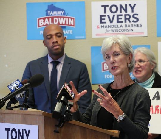 Former Kansas governor and U.S. Secretary of Health and Human Services Kathleen Sebelius (right front) joins Democratic lieutenant governor nominee Mandela Barnes (left) in Milwaukee for a campaign stop focused on health care Monday.