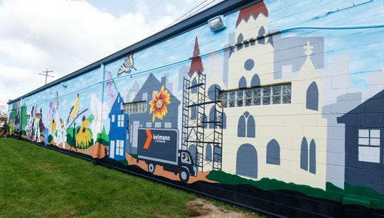 A mural painted by local artist Fred Kaems is seen on the south side of the Kelmann Restoration building on Monday, Oct. 15. The mural, commissioned by Kelmann Restoration, faces the Hank Aaron Trail near 121st Street in Wauwatosa.