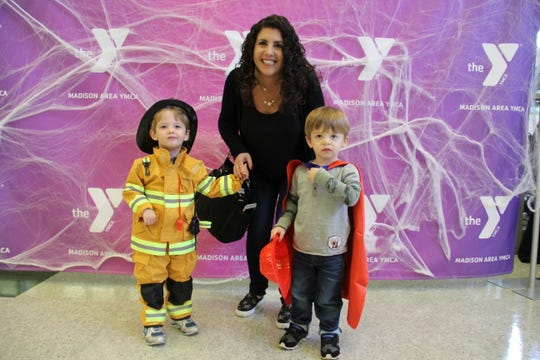 """Fireman"" Andrew Schneidkraut, 2.5, and his twin, ""Superman"" Nathan Schneidkraut, from Boonton Township with their mom, Stacey Cozewith, at the 2017 Madison Area YMCA Halloween Spooktacular."