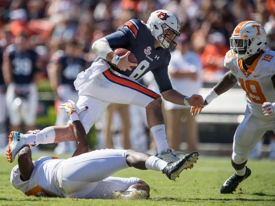 Auburn's Jarrett Stidham (8) hurdles over a defender as he scrambles out of the backfield against Tennessee at Jordan-Hare Stadium in Auburn, Ala., on Saturday, Oct. 13, 2018. Tennessee defeated Auburn 30-24.