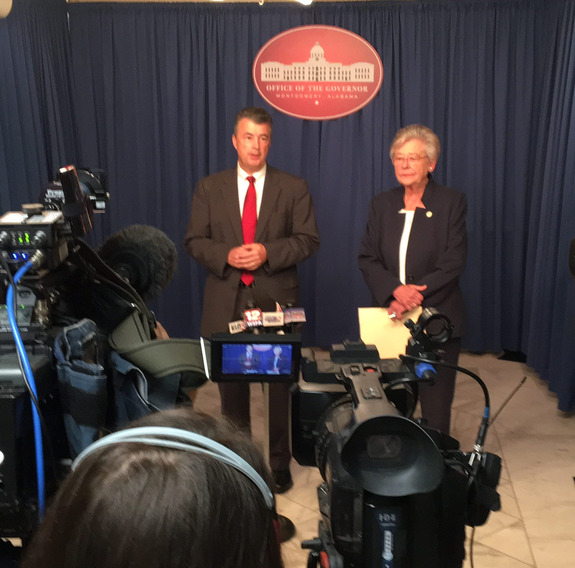 Attorney General Steve Marshall (left) and Gov. Kay Ivey speak to the media about a moratorium on early paroles on Monday, Oct. 15, 2018.