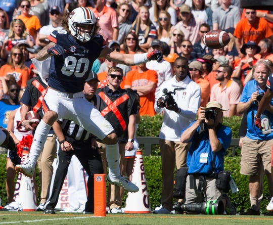 Auburn's Sal Cannella (80) watches as a tipped ball sails by  in the end zone at Jordan-Hare Stadium in Auburn, Ala., on Saturday, Oct. 13, 2018. Tennessee defeated Auburn 30-24.