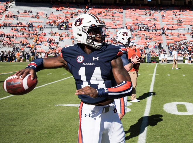 Auburn's Malik Willis (14) warms up with other quarterbacks at Jordan-Hare Stadium in Auburn, Ala., on Saturday, Oct. 13, 2018. Tennessee defeated Auburn 30-24.