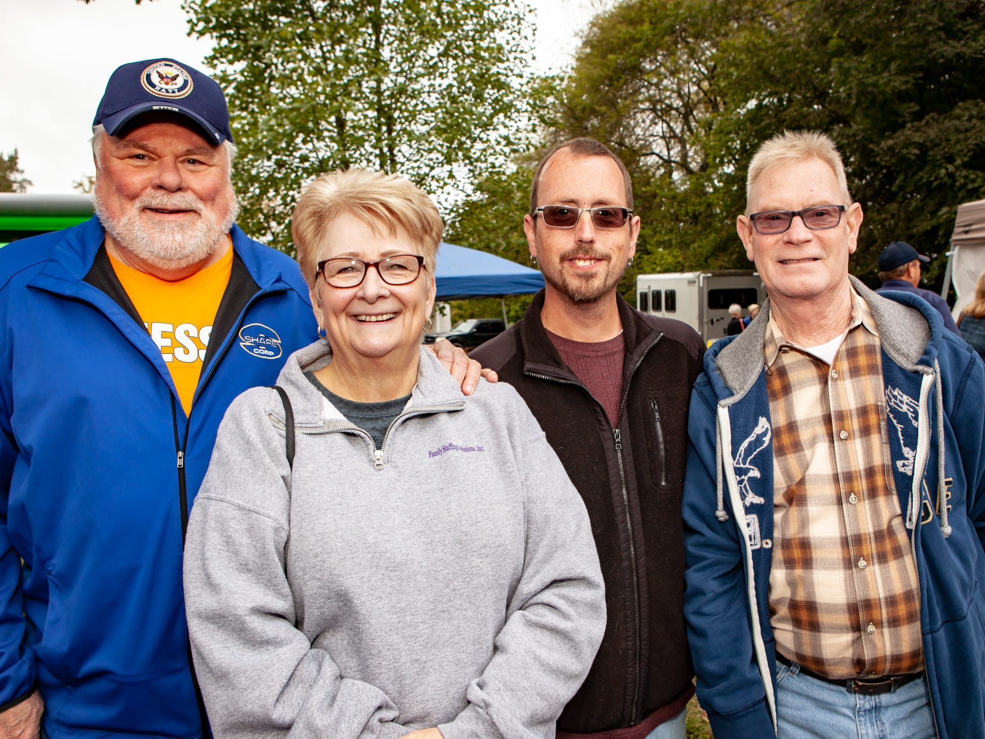 Rick and Cathy Bennett with Dale Maxwell and Don Sivells at The Gathering at Milton's fall market and craft fair on Saturday, Oct. 13, 2018.