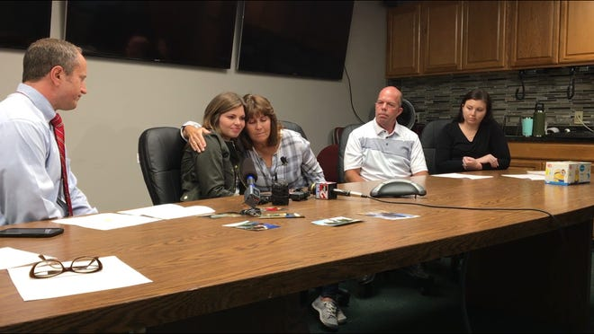 Rutherford County Sheriff's Office Capt. Britt Reed, left, watches as Janet Hawkins comforts her daughter, Brandi Jackson, during a press conference marking the third anniversary of the death of Gregg Hawkins, flanked by his late fisherman's brother Darren Hawkins and daughter Logan LaRese watch. The family was at the Rutherford County Sheriff's Office Oct. 15, 2018, to mark the third anniversary of Hawkins' unsolved death, which happened Oct. 16, 2015.