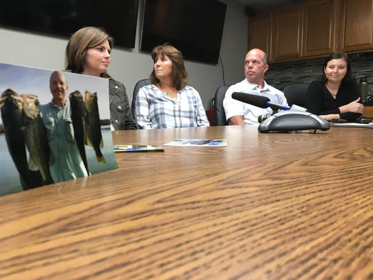 Family members of late fisherman, Gregg Hawkins, seen in the photo at left, are, from left, daughter Brandi Jackson, wife Janet Hawkins, brother Darren Hawkins and daughter Logan LeRese. The family was at the Rutherford County Sheriff's Office Oct. 15, 2018, to mark the third anniversary of Hawkins' unsolved death, which happened Oct. 16, 2015.