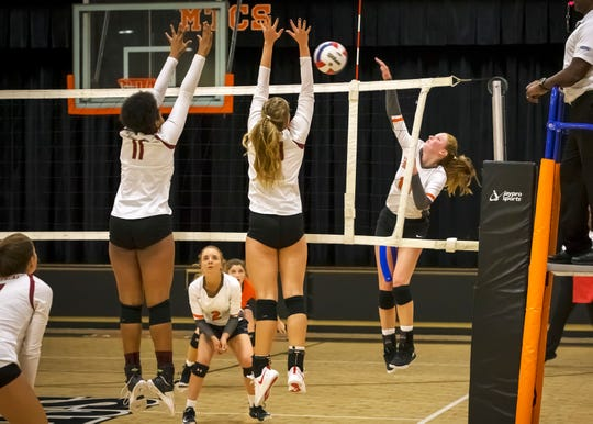 MTCS' Mackenzie Harris goes for a kill during a 2018 DII-A state tournament match.