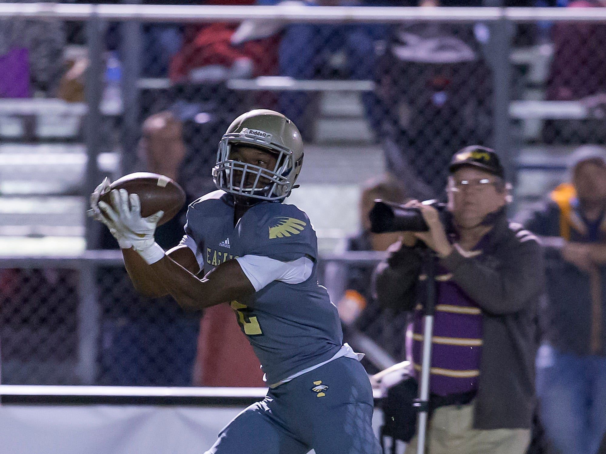 Independence's TJ Sheffield makes a catch and run for a touchdown against Dickson County.
