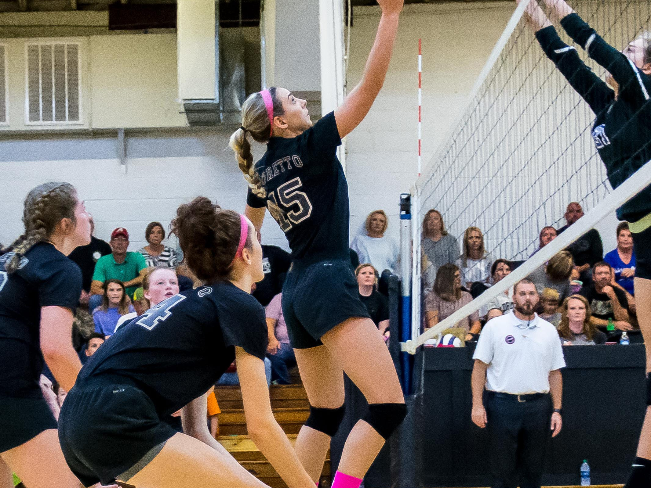 Loretto's Mary Beth Cotton, a senior, with the return at the net!