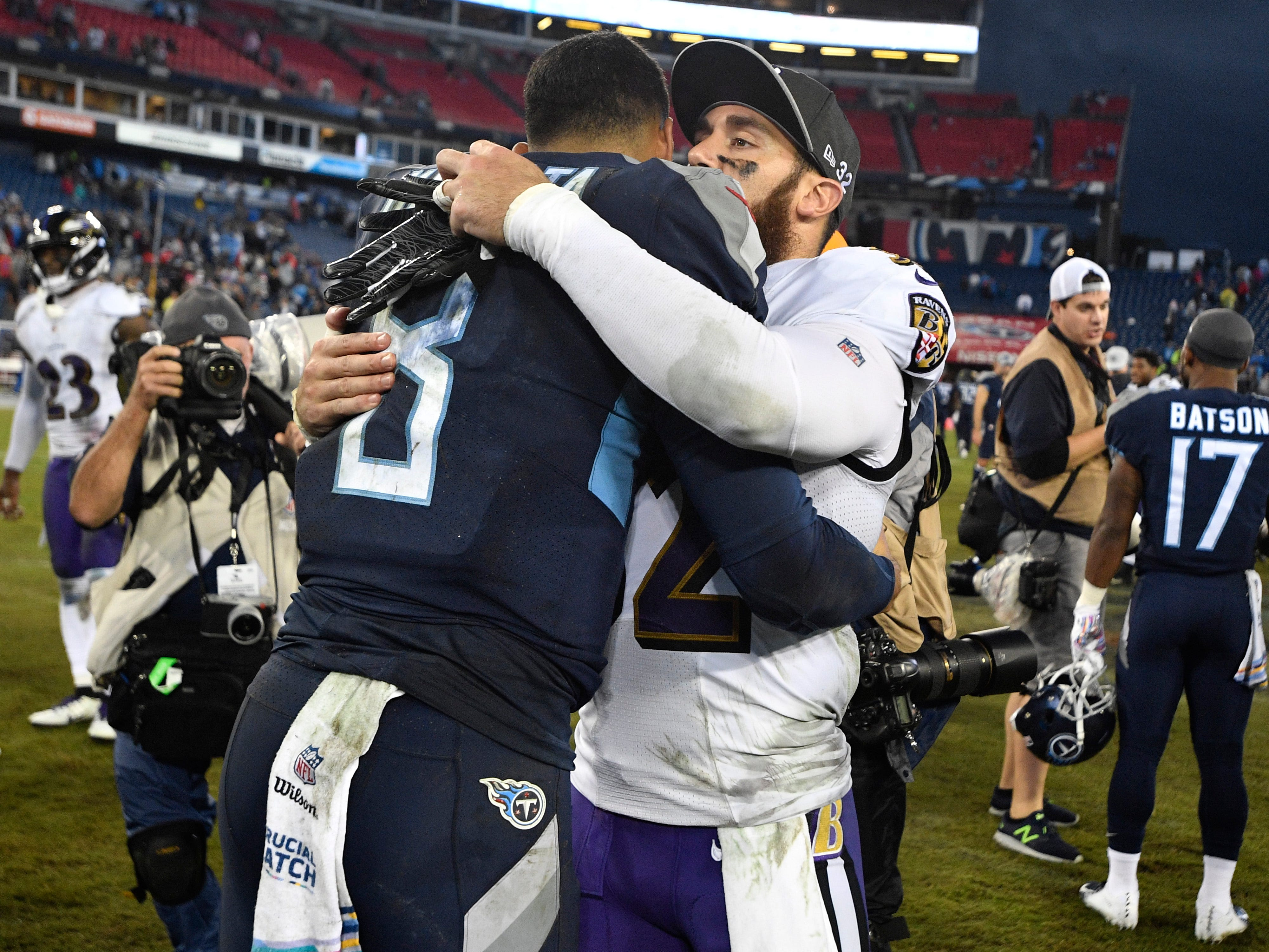 Titans quarterback Marcus Mariota (8) hugs Ravens free safety Eric Weddle (32) after the Titans' 21-0 loss at Nissan Stadium Sunday, Oct. 14, 2018, in Nashville, Tenn.