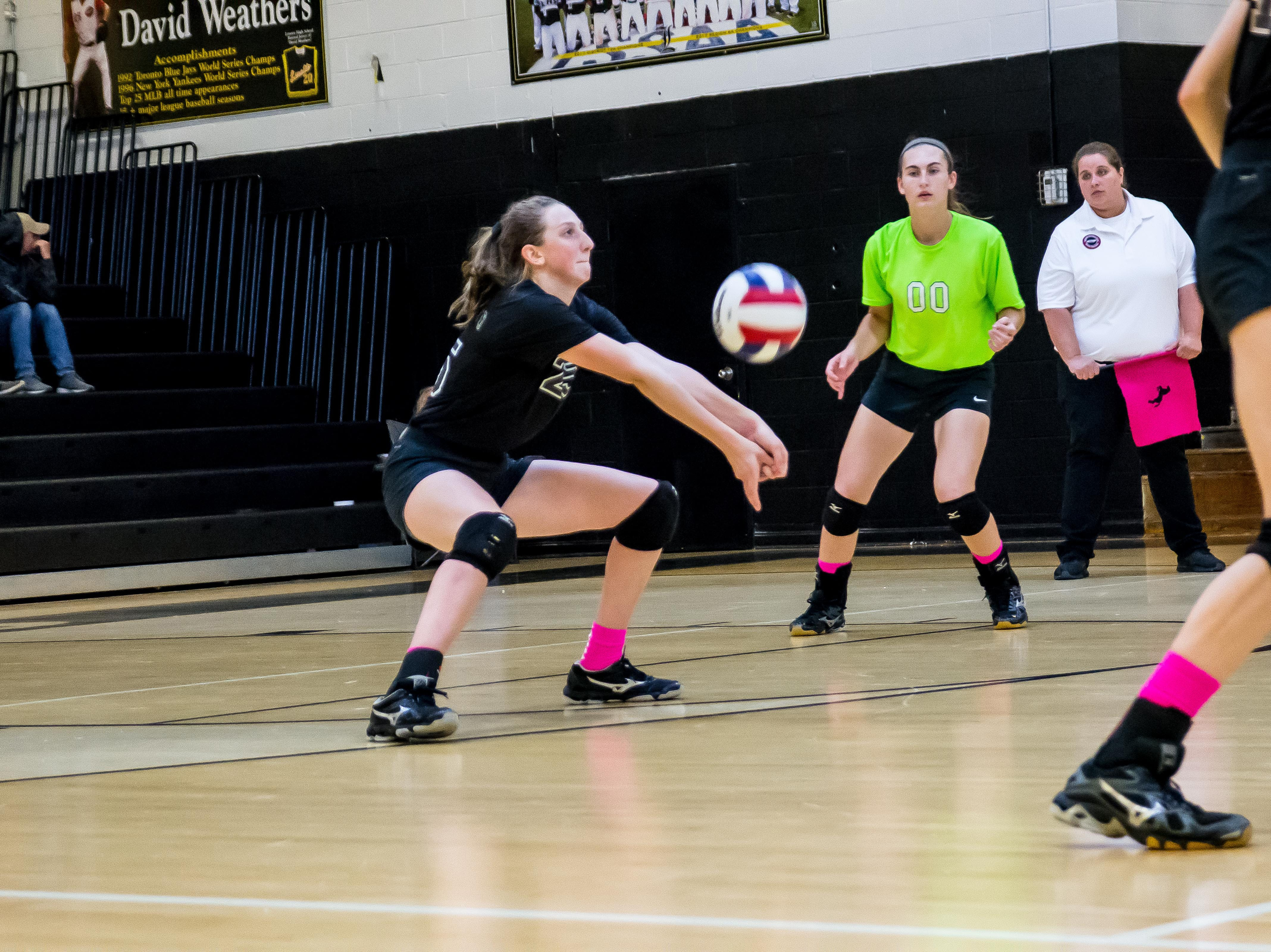 Loretto freshman Karly Weathers, the daughter of former MLB pitcher David Weathers, with the dig.