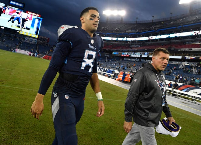 Titans quarterback Marcus Mariota (8) walks off the field after the team's 21-0 loss to the Ravens on Sunday.
