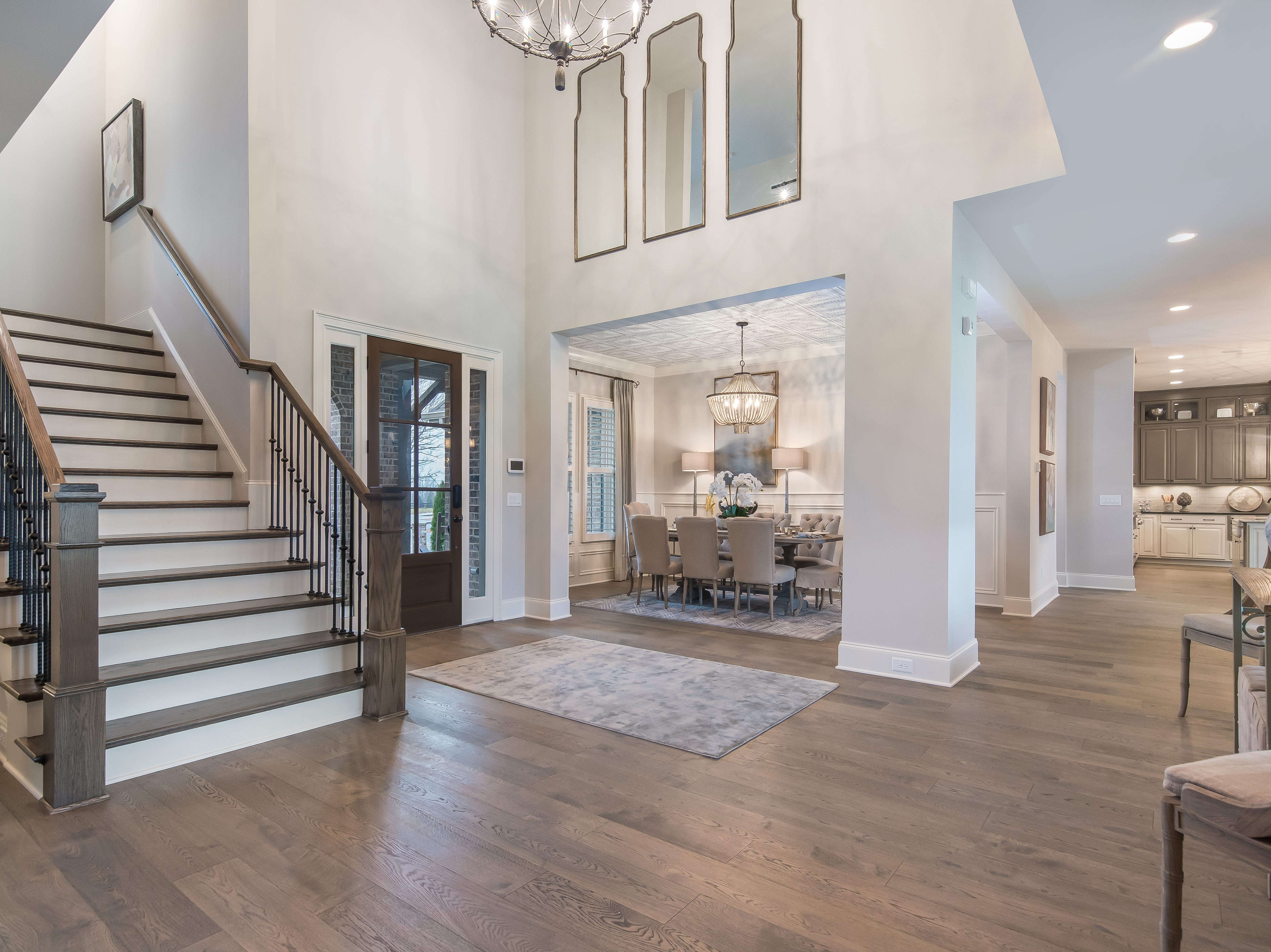 The model home is stocked with upgrades such as this commercial-grade hardwood flooring.
