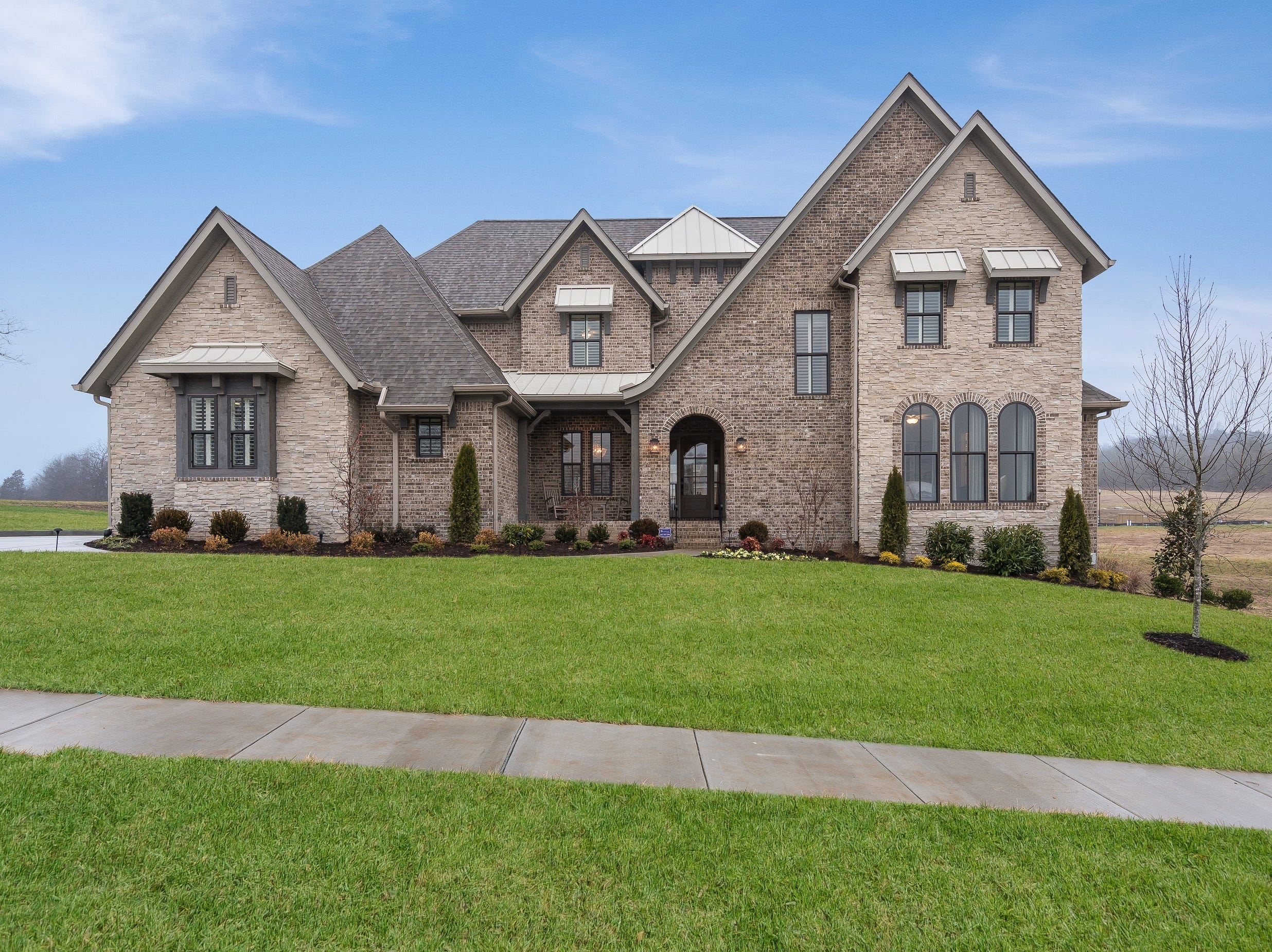 The home at 6003 Lookaway Circle is the Lookaway Farms model home. It is currently listed for sale.