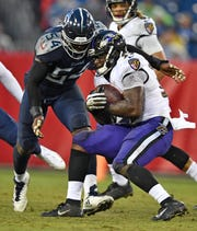 Titans linebacker Rashaan Evans (54) closes in on Ravens running back Gus Edwards (35) in the fourth quarter at Nissan Stadium Sunday, Oct. 14, 2018, in Nashville, Tenn.