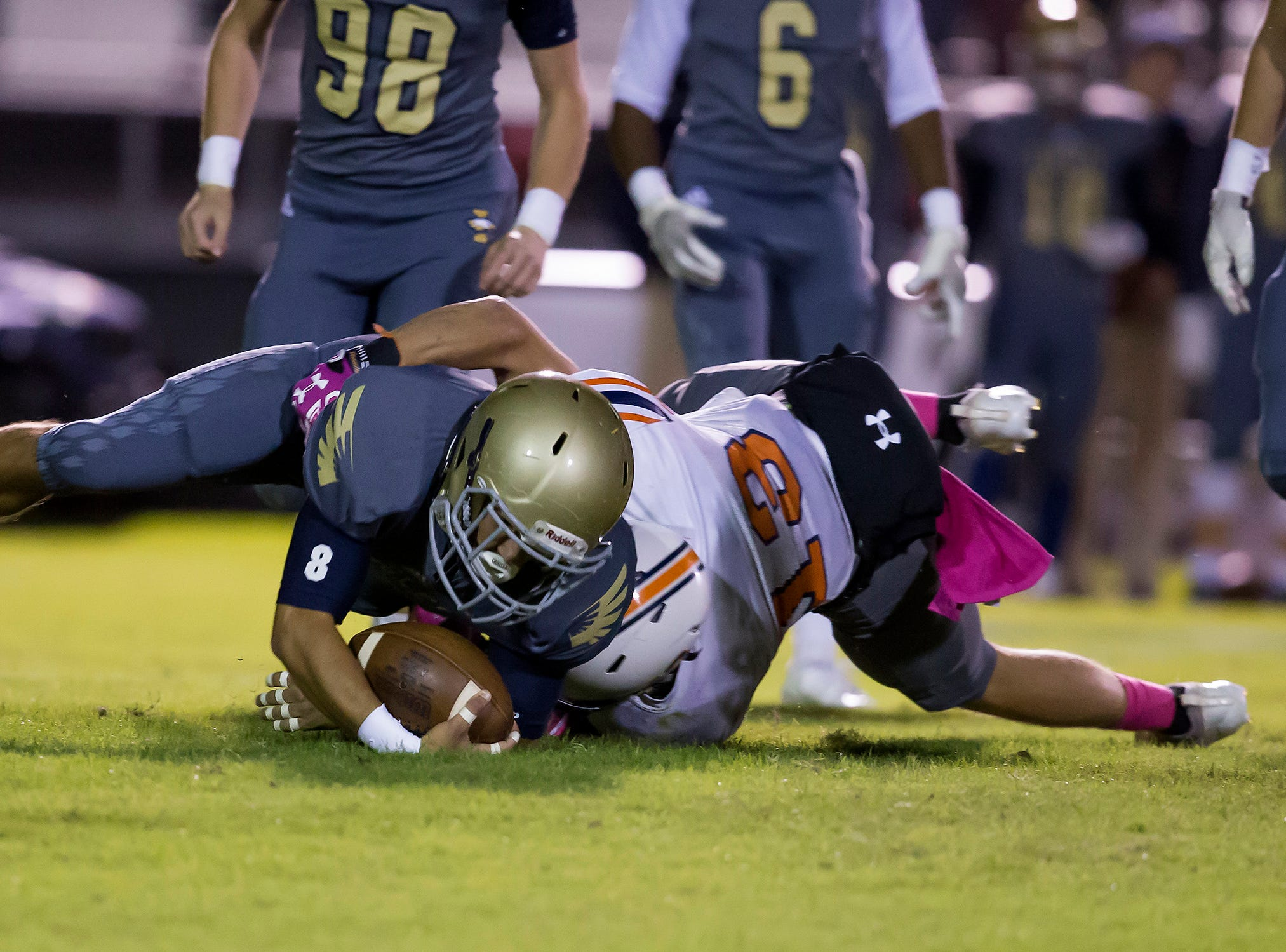 Independence's Jake Huner is tackled by Dickson County's Stewart Conner.