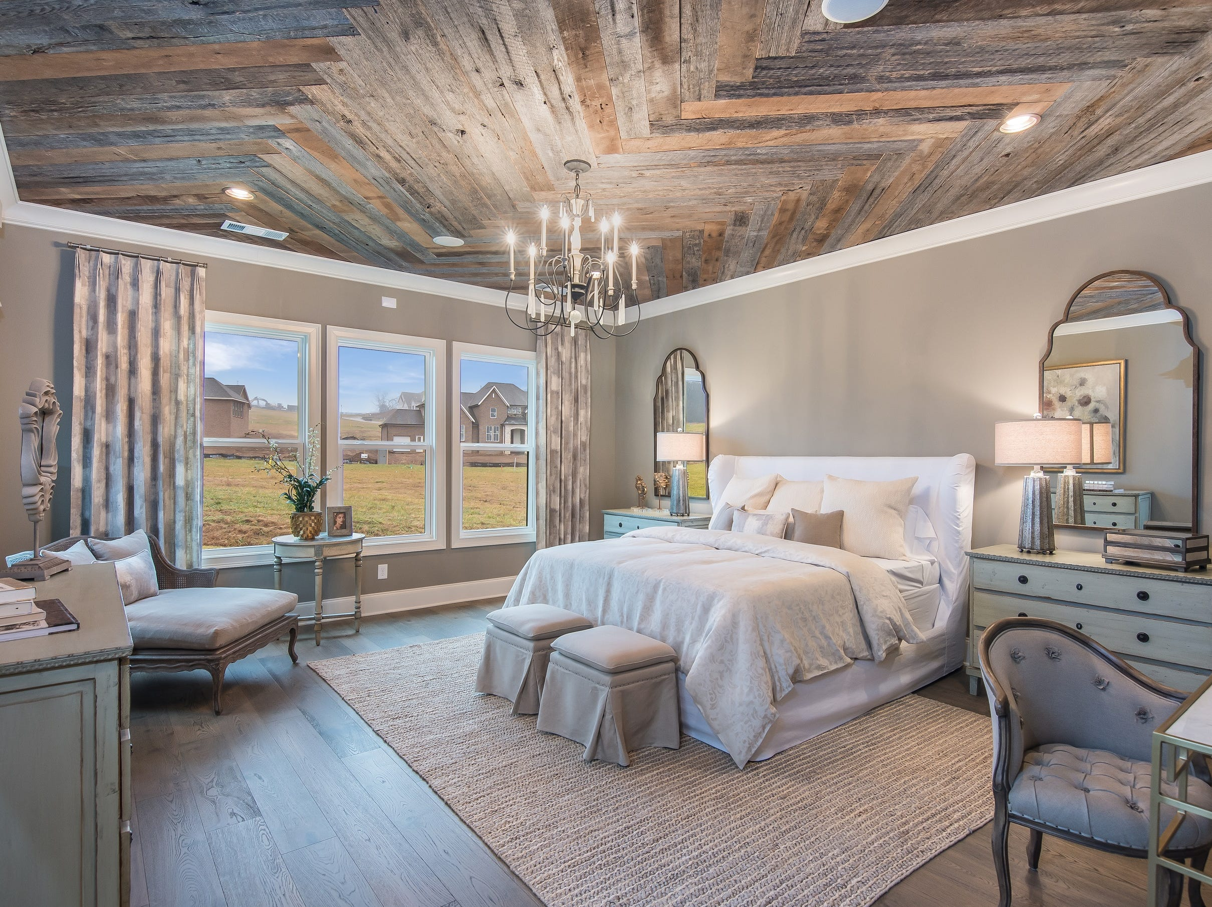 This barn wood ceiling in the home's master bedroom is another feature that would be considered an upgrade. In this model home, which is listed for sale, it comes with the house.
