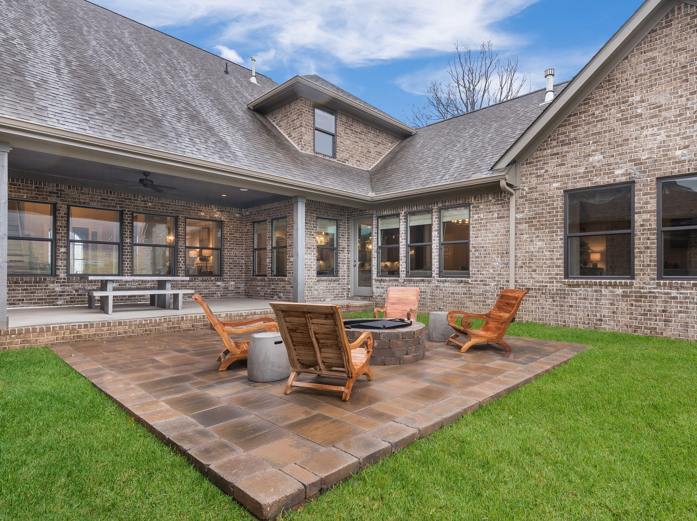 The patio and fire pit are upgraded features that are a part of this model home, which is on the market.