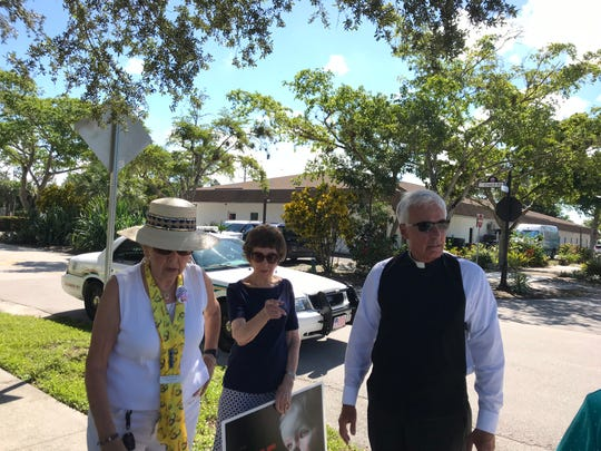 From left, Carol Gentile, Eileen Warburton and Father Michael Orsi talk about a fight that occurred outside Planned Parenthood in Naples on Monday, Oct. 15, 2018. Charges will not be filed.