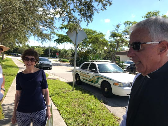 Eileen Warburton and Father Michael Orsi talk about a fight that occurred outside Planned Parenthood in Naples on Monday, Oct. 15, 2018. Charges will not be filed.