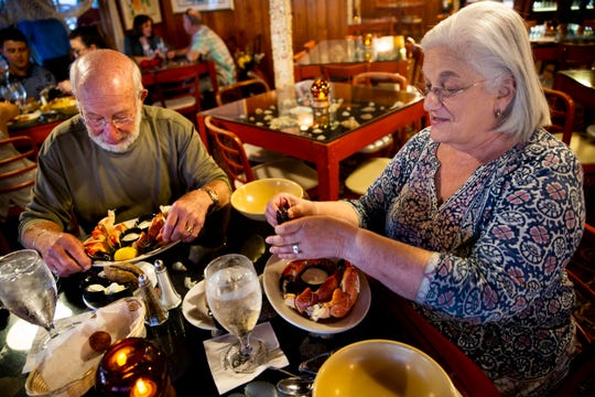 Nancy and Donald Resnick eat their dinner on the first day of stone crab season on Monday, October 15, 2018, at Kelly's Fish House Dining Room in Naples.