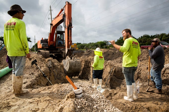 From left, Dylan Kennaelly, Carlos Torres, Tyler Dibert and Disidoro Popoca work on building the Naples Motor Condos on Wednesday, Oct. 10, 2018, on Livingston Road in Naples.