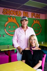 Owners Doug Miller and Amy Eldridge inside their restaurant FK Your Diet in Fort Myers on Friday, Oct. 12, 2018. The FK in the title stands for foster kids and five percent of their revenue will be donated to organizations that help foster kids.