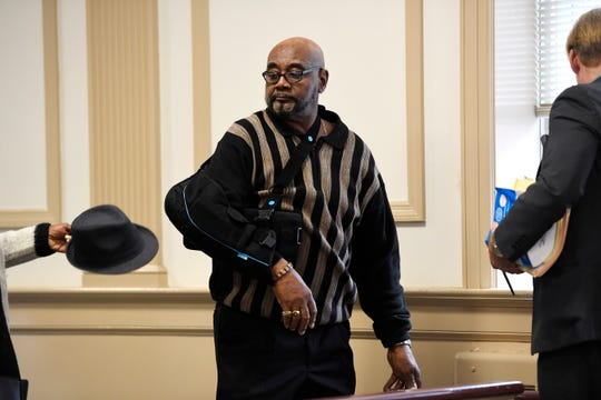 """Hudy Muldrow Sr. walks out of the Morris County courtroom with his right arm in a sling after a """"review hearing"""" in Morristown, NJ on Monday, Oct. 15, 2018.  Muldrow Sr. is charged with two counts of vehicular homicide for allegedly driving recklessly and causing the deaths of one child and one teacher from a Paramus middle school in May."""