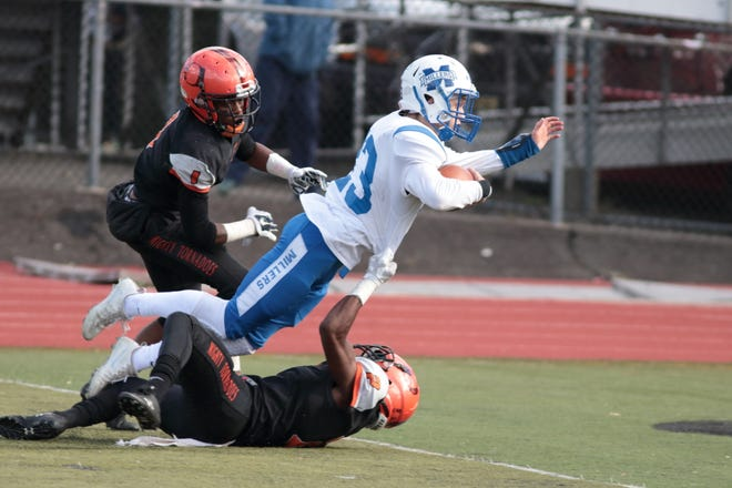 Millburn running back Luka Gotsadze dives into the end zone for the winning touchdown at Orange.