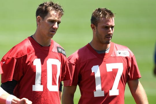 New York Giants quarterbacks Eli Manning (10) and Kyle Lauletta (17) walk off the field to end the first day of mandatory minicamp in East Rutherford, NJ on Tuesday, June 12, 2018.
