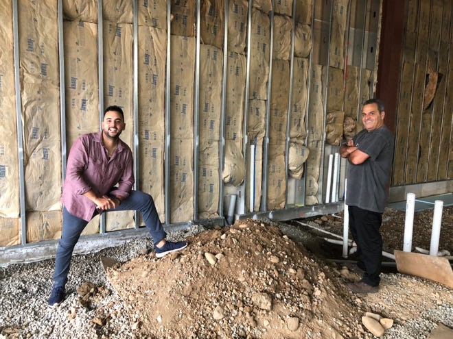 Anthony, left, and Sonny, right, break ground on their new pizza restaurant Pazza.