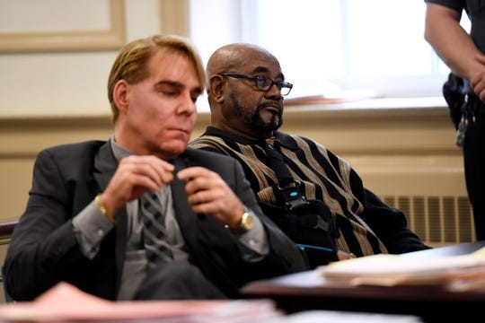 Hudy Muldrow Sr., right, sits with his defense attorney Matthew Reisig, during an appearance in front of Judge Stephen Taylor at the Morris County Courthouse in Morristown, NJ on Monday, Oct. 15, 2018.