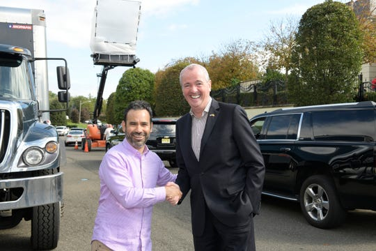 """Pictured: (l-r) """"The Enemy Within"""" Executive Producer Matt Corman with NJ Gov. Phil Murphy (Photo by: Virginia Sherwood/NBC)"""
