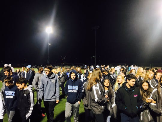 Waldwick students and fans rush onto the field at Ramsey High School after their team's shootout win over Ridgewood in the 2018 Bergen County quarterfinals.