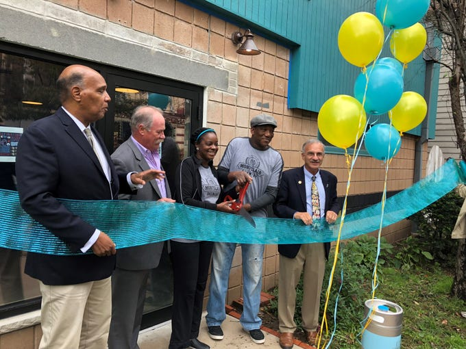 Mayor Robert Jackson, council member Rich McMahon, Denise Ford Sawadogo, Leo Sawadogo and council member Bob Russo cut the ribbon on opening day at the Montclair Brewery. October 13, 2018.