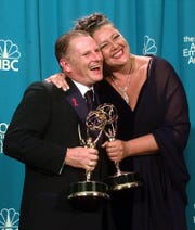 "Gordon Clapp and Camryn Manheim embrace backstage at the 50th Annual Primetime Emmy Awards at the Shrine Auditorium in Los Angeles, Sunday, Sept. 13, 1998. Clapp won Best Supporting Actor in a Drama Series for ""NYPD Blue,"" and Manheim won Best Supporting Actress in a Drama Series for ""The Practice."" (AP Photo/Reed Saxon)"