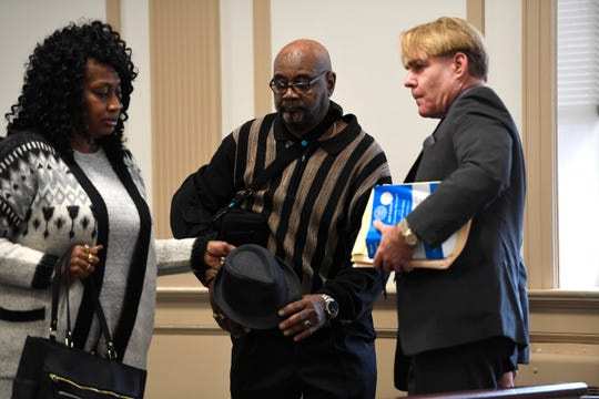 """Hudy Muldrow Sr., center, walks out of the Morris County courtroom with a family member and his defense attorney Michael Reisig, far right, after a """"review hearing"""" on Monday, Oct. 15, 2018 in Morristown."""