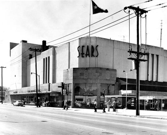 This March 1, 1959, file photo shows a Sears building in downtown Houston. Sears has filed for Chapter 11 bankruptcy protection Monday, Oct. 15, 2018, buckling under its massive debt load and staggering losses. The company once dominated the American landscape, but whether a smaller Sears can be viable remains in question.