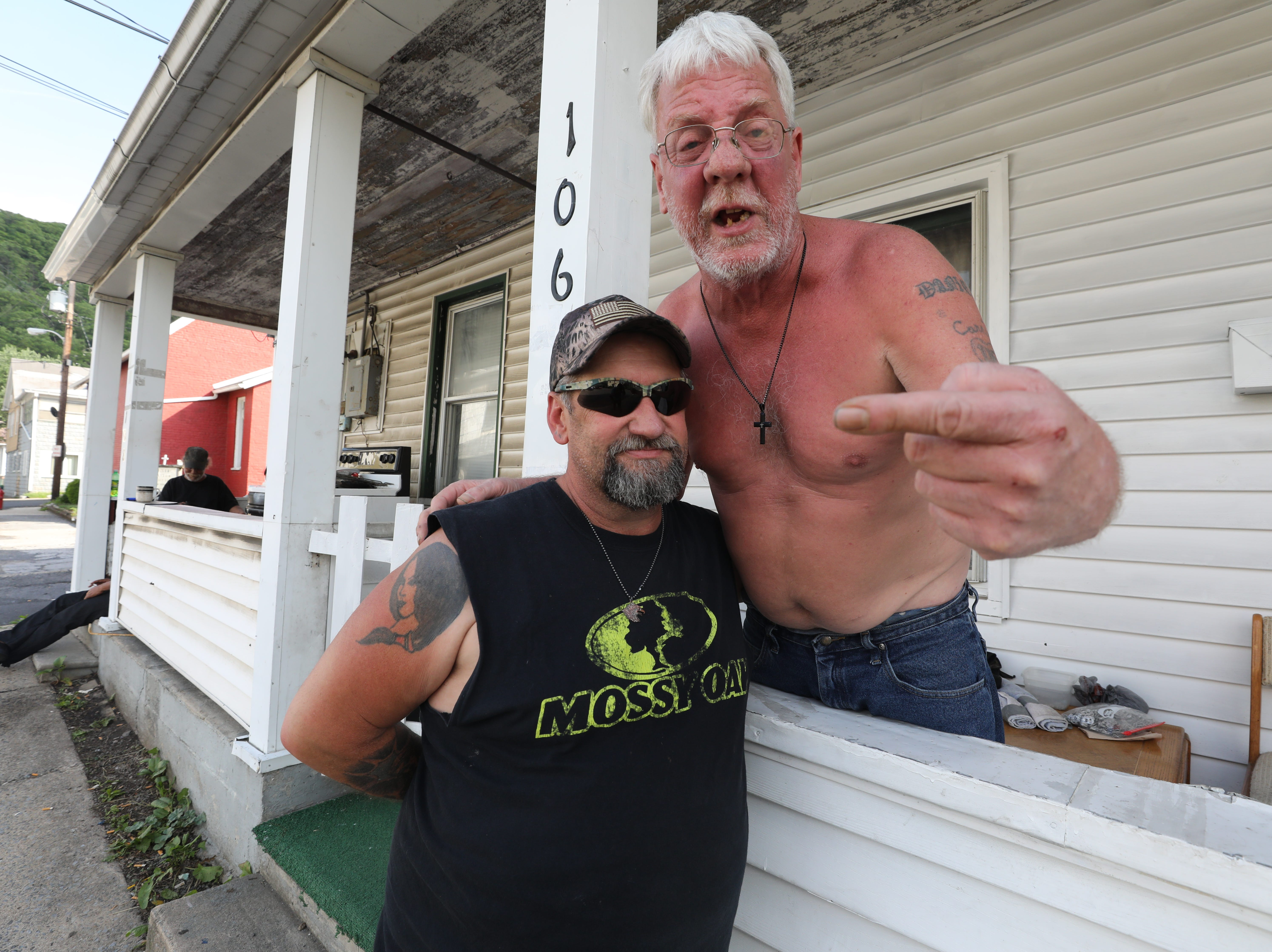Timothy McCusker Sr. and his friend Danny McCarty are both unemployed and spent this afternoon drinking beer on the porch of McCarty's home. The one and a half bedroom apartment costs $450 per month.