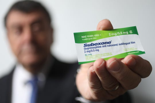 Dr. Ken Faistl poses with Suboxone, a medication-assisted treatment for opioid overdoses. Wednesday, October 10, 2018