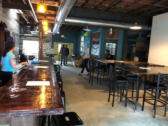 The reclaimed wood in the Montclair Brewery, a barn door in another life,  was donated by Kaden Productions of Montclair.
