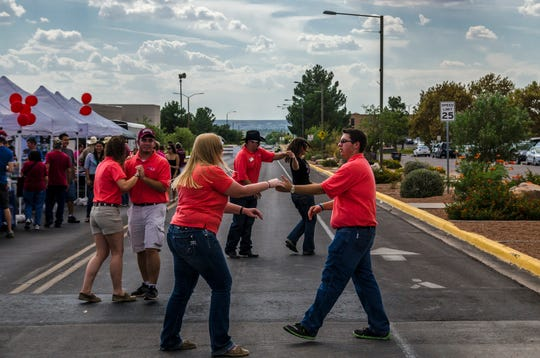 Attendees two-step to music at the 2013 AG Day. The sixth annual AG Day is Saturday, Oct. 20.