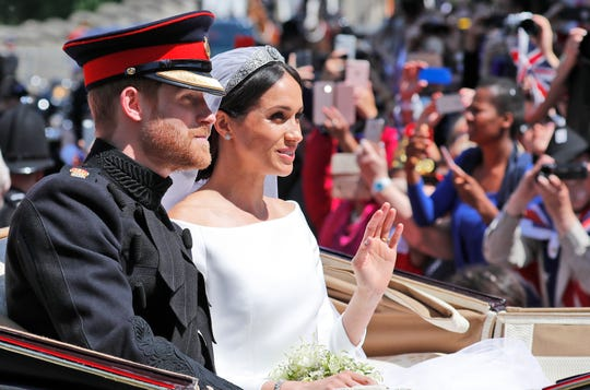 In this file photo dated May 19, Britain's Prince Harry and his bride Meghan Markle, ride in a carriage after their wedding ceremony at St. George's Chapel in Windsor Castle in Windsor, near London, England. Kensington Palace announced on Monday that Prince Harry and his wife the Duchess of Sussex are expecting a child in spring 2019.