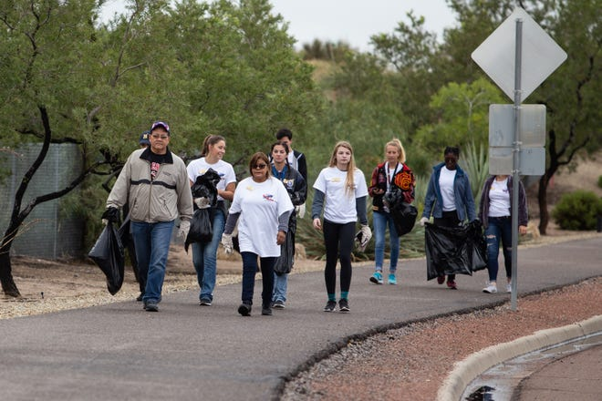 Las Cruces mayor Ken Miyagishima leads a troop of the Mayor's Top Teens during the Toss No Mass citywide cleanup event held on Saturday, Oct. 13, 2018.